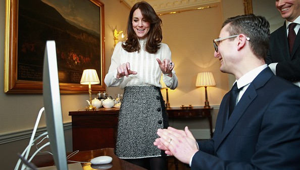 LONDON, ENGLAND - FEBRUARY 17:  Catherine, Duchess of Cambridge talks to James Martin (Executive Editor Huff Post UK) and Steven Hull (Editor in Chief Huff Post UK) on the Huffington Post landing page in the 'News Room' at Kensington Palace on February 17, 2016 in London, England. The Duchess of Cambridge is supporting the launch of the Huffington Post UK's initiative 'Young Minds Matter' by guest editing the Huffington Post UK today from Kensington Palace.  (Photo by Chris Jackson - WPA Pool/Getty Images)